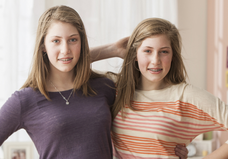 teenage girls with braces smiling
