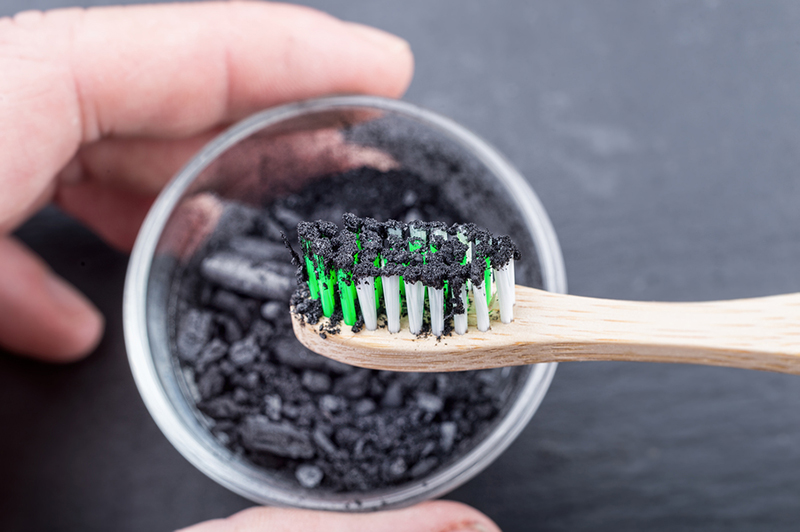 Charcoal On A Toothbrush To Whiten Teeth