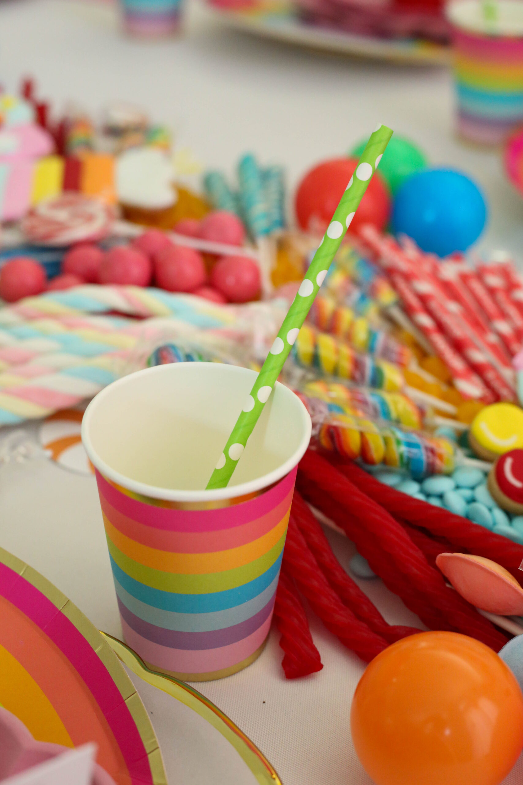 rainbow party cups with lime green polka dot straws
