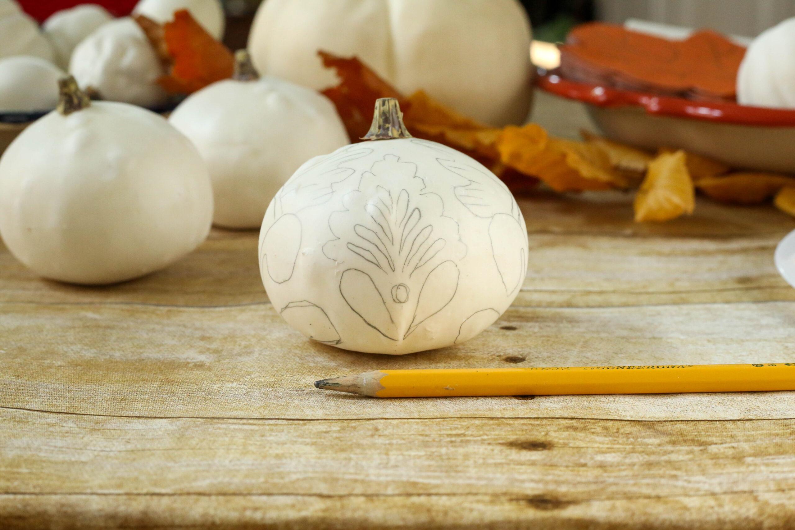 sketch design onto gourd