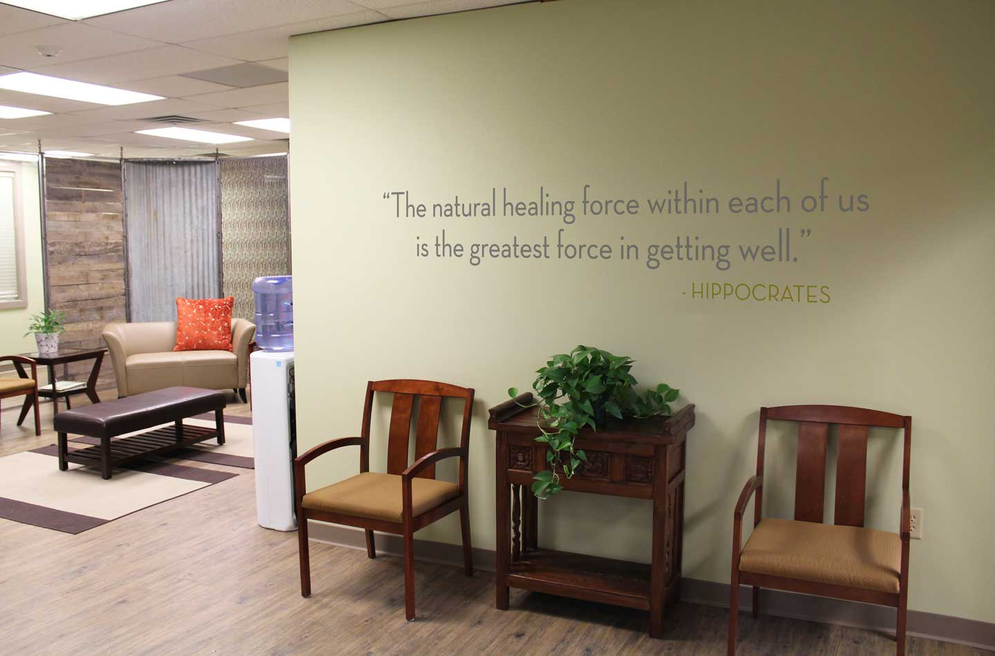"""Wall sign that reads: The natural healing force within each of us is the greatest force in getting well."""" - Hippocrates"""
