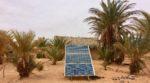 Solar panel in Sahara oasis below Erg Chebbi