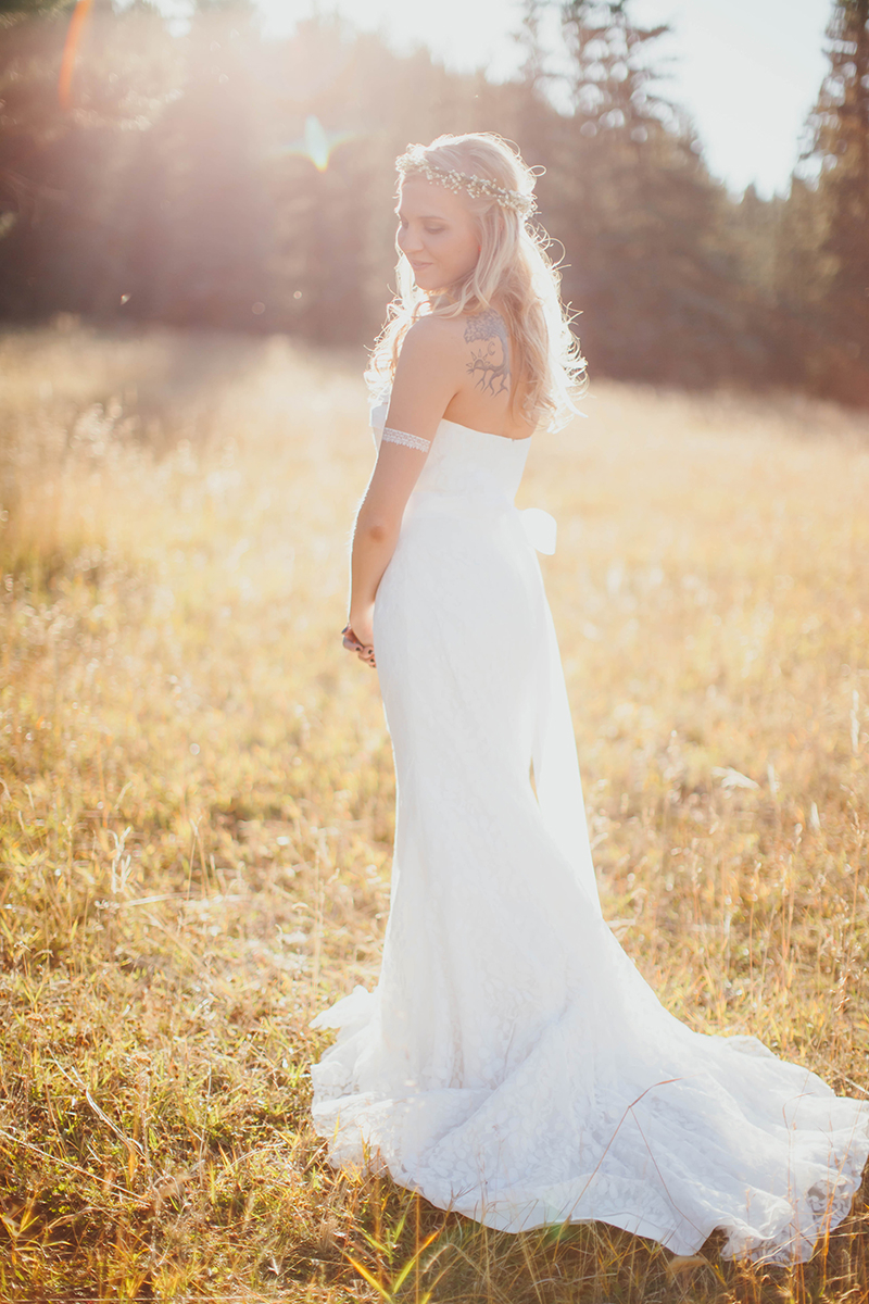 A bride stands posing at sunset wearing a white dress for this Lower Lake Ranch wedding photography session