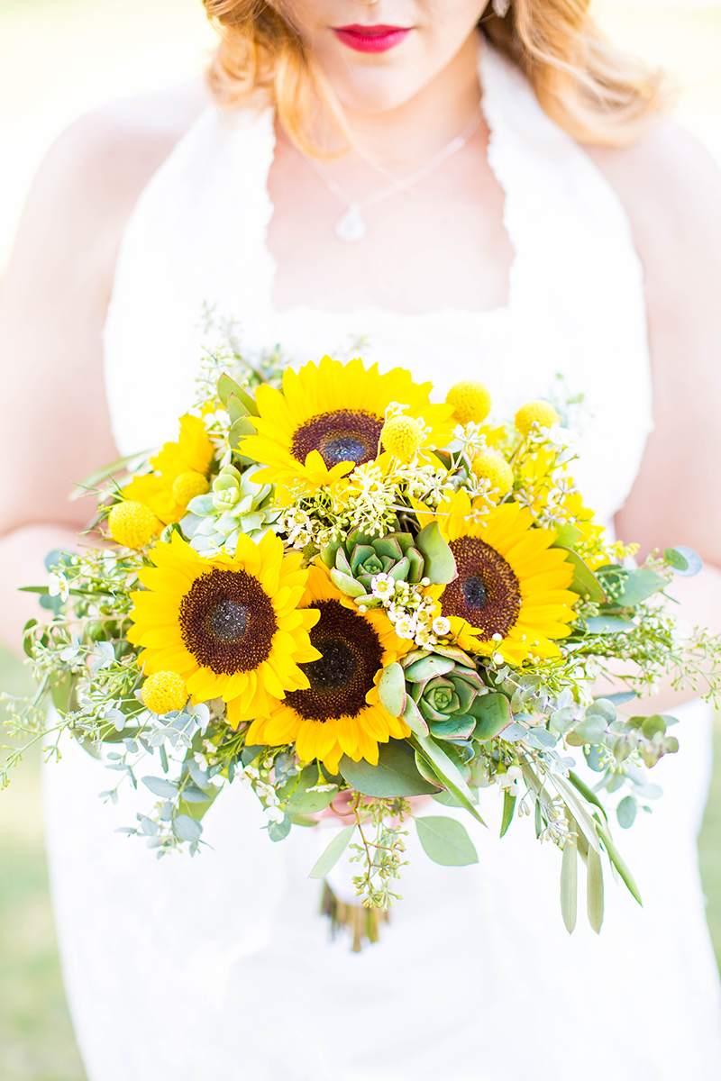 A bride holding her bouquet wearing a white dress for this Camarillo Ranch wedding photography session