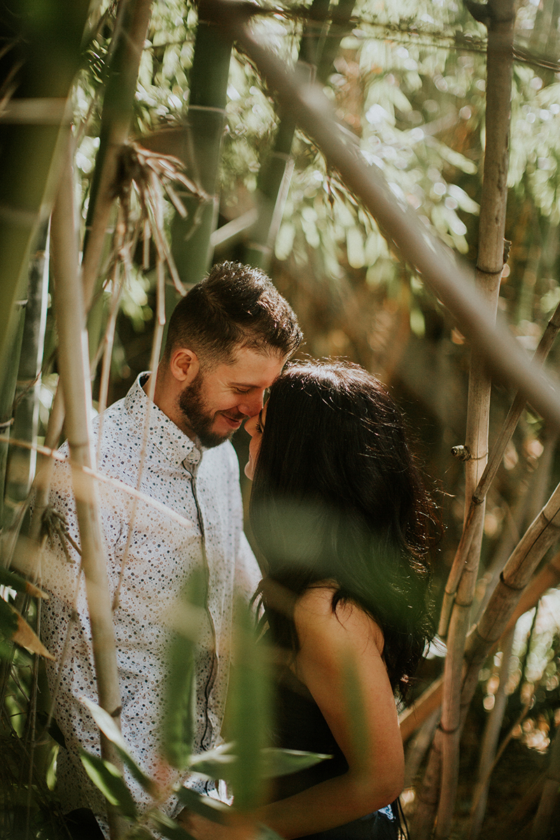 A couple hold each other in a bamboo forest at the Los Angeles County Arboretum and Botanic Garden for this Los Angeles engagement photography session