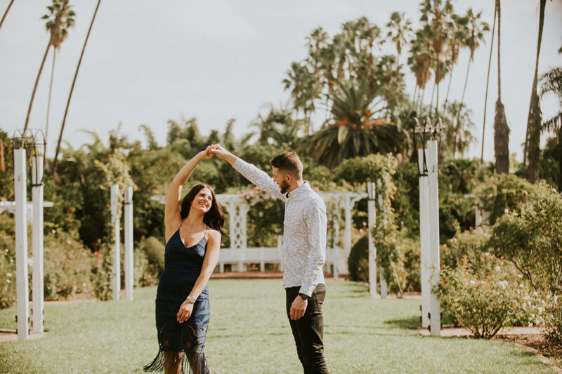 A couple dance together at the Los Angeles County Arboretum and Botanic Garden for this Los Angeles engagement photography session