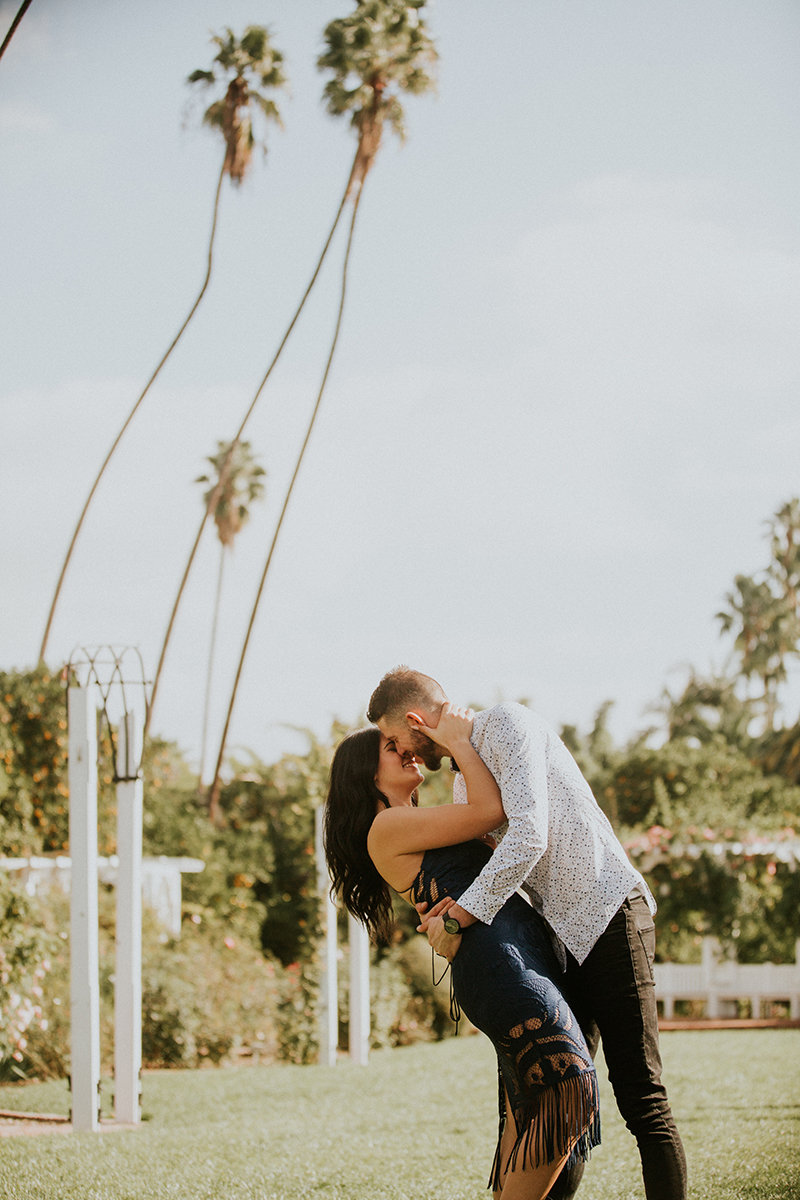 A couple hold each other and dip at the Los Angeles County Arboretum and Botanic Garden for this Los Angeles engagement photography session