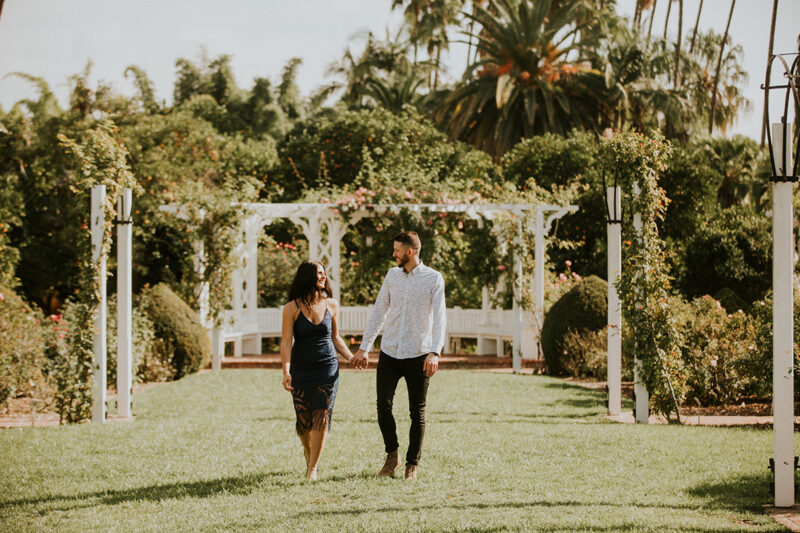 A couple walk together at the Los Angeles County Arboretum and Botanic Garden for this Los Angeles engagement photography session