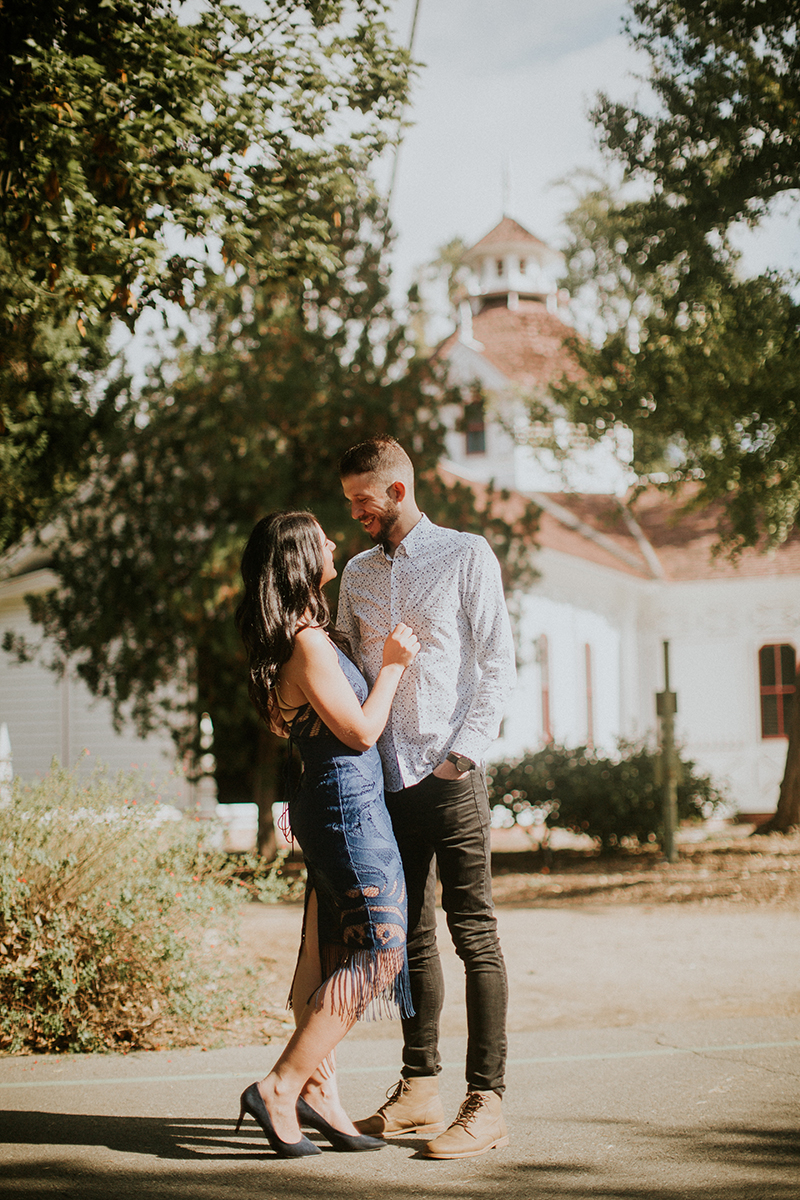 A couple hold each other at the Los Angeles County Arboretum and Botanic Garden for this Los Angeles engagement photography session