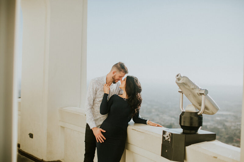 A couple hold each other at the Los Angeles Observatory for this Los Angeles engagement photography session