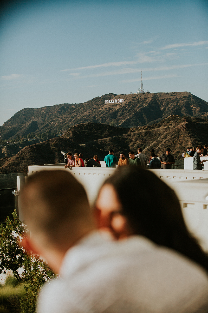 A couple talk at the Los Angeles Observatory for this Los Angeles engagement photography session