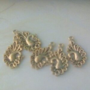 Antique peacock charms