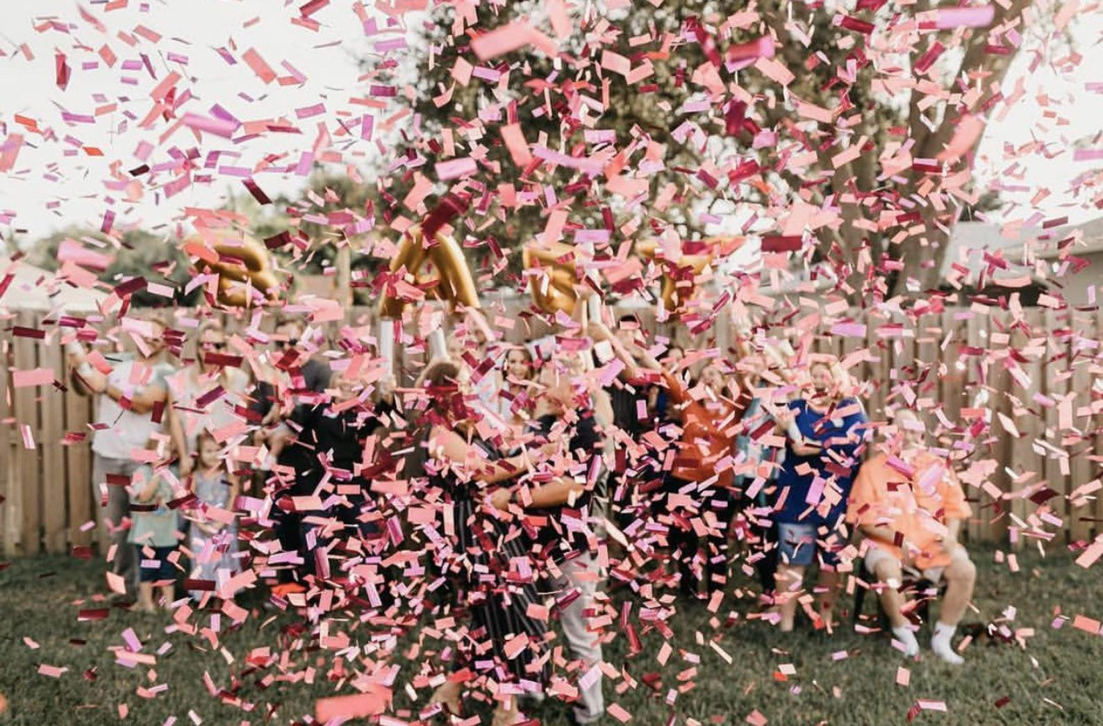 gender reveal pink confetti