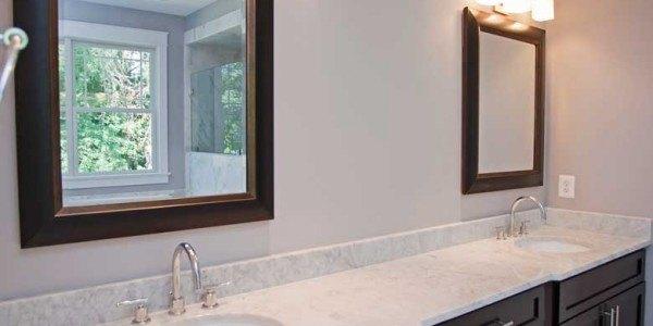 Bathroom remodel in Northern VA, MD, DC; marble countertop, marble tub, marble floor, oversized shower, dark cabinets