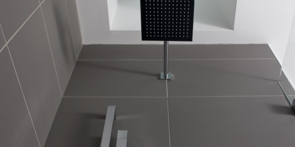 Bathroom remodel in Northern VA, MD, DC; white cabinets; marble tile floor; rainfall shower