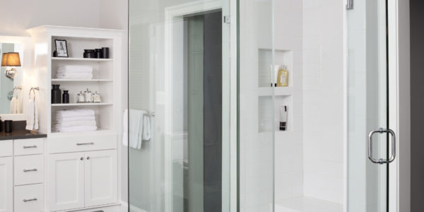 Luxury bathroom remodel in Northern VA, MD, DC; white cabinets; bathroom seating; glass tile shower; rainfall shower