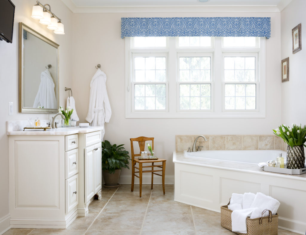 Classic bathroom remodel in Northern VA, MD, DC; white cabinets; tile floor; spa style tub