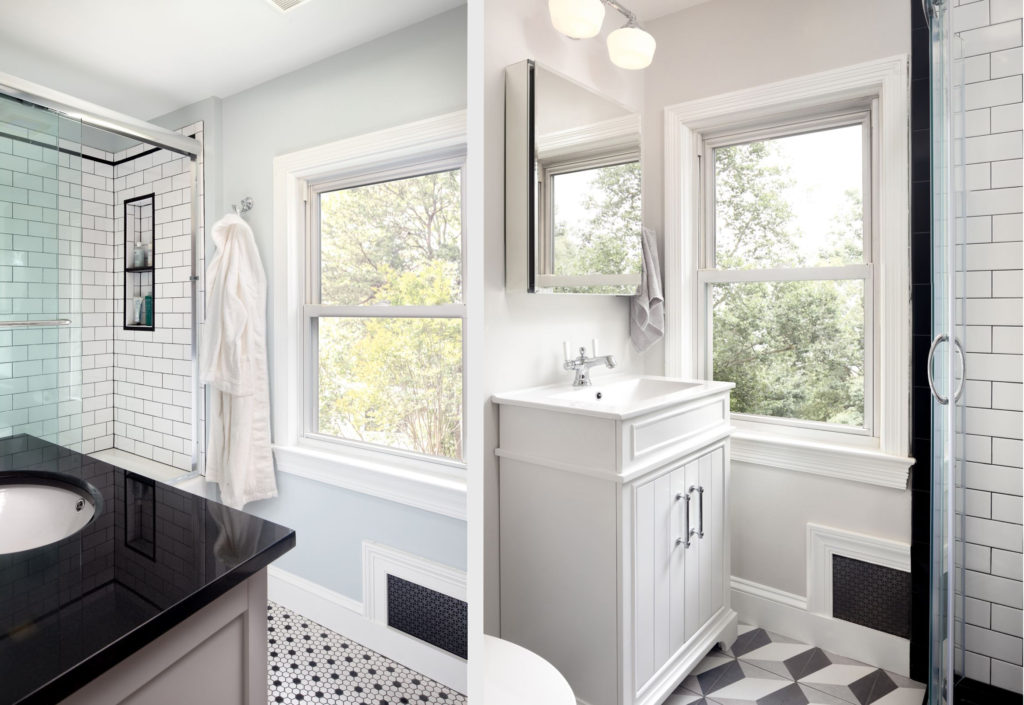 Clean and sleek white bathroom remodeling project