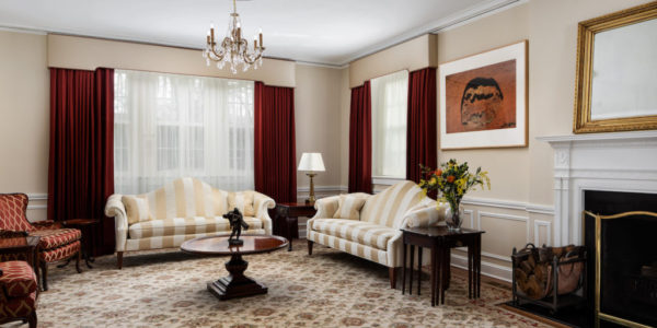 Home remodeling project with burgundy and gold detailing in living room