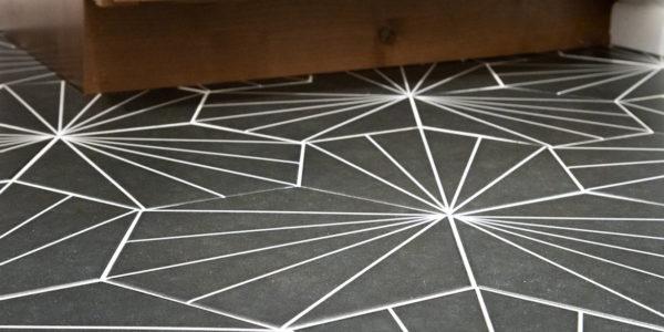 Intricate floor pattern in remodeled bathroom