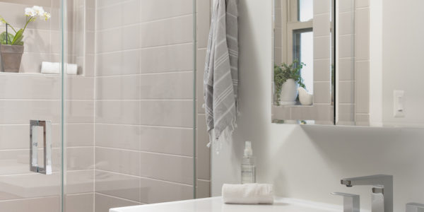 Renovated Bathroom with clear shower doors and neutral tones