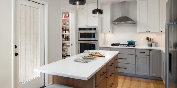 Renovated kitchen with white and gray designs