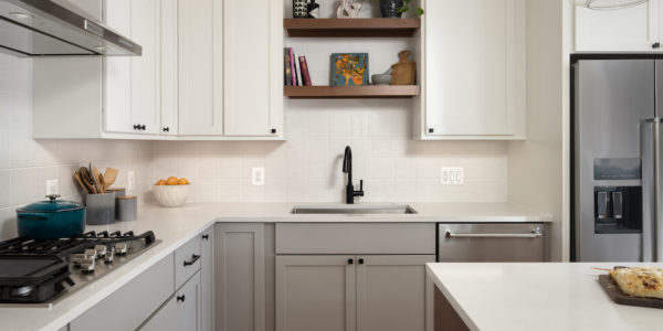 Kitchen cabinets and island in white and gray tones