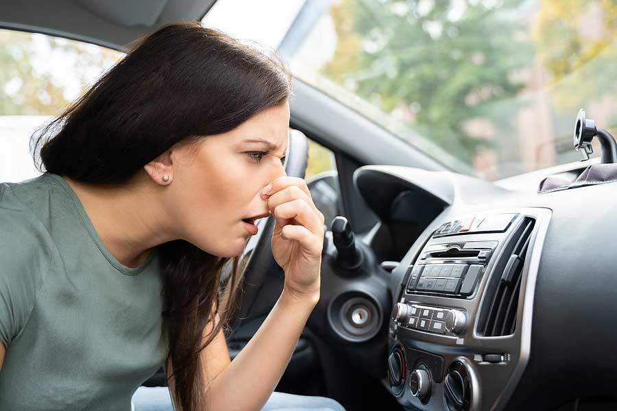 What smelling exhaust inside the car means.