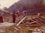 """""""RO"""" Miller (gray hat, center), son-in-law Larry Pearce (red hat), and his brother Carl Pearce (white shirt, right)  Bridge project to Larry's new house, Oct. 1974"""