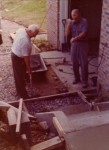 """Ralph Pearce & """"RO"""" Miller pouring Larry & Susan's new front entrance July 5, 1976"""