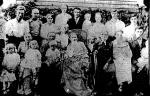 Daniel D. Brenneman (1824-1918 center in wheelchair) with family