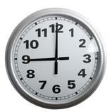 A stylish wall clock showing 9 o'clock, isolated on white with clipping path