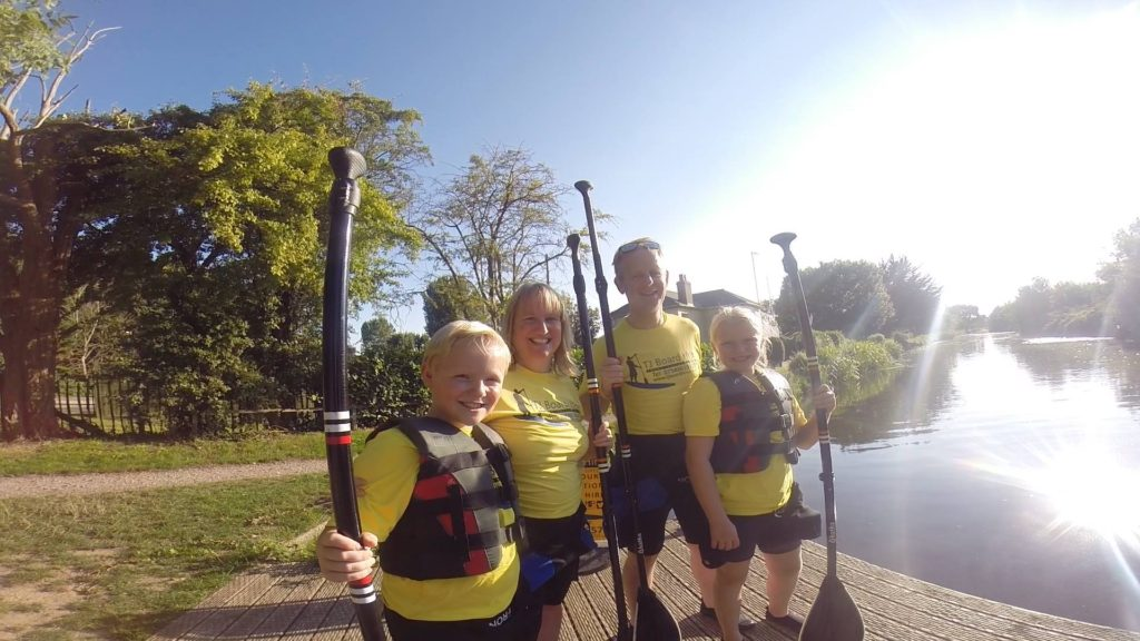 family paddleboarding lesson in West Sussex