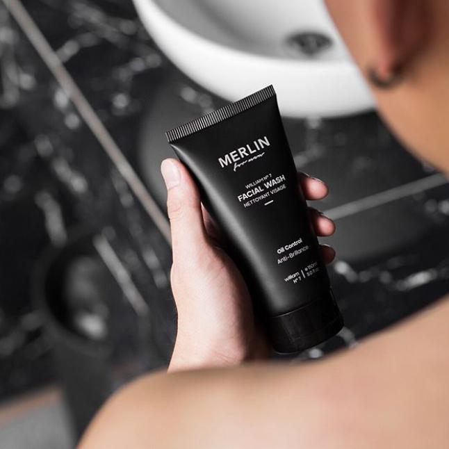Men is holding Merlin for Men face wash in hand