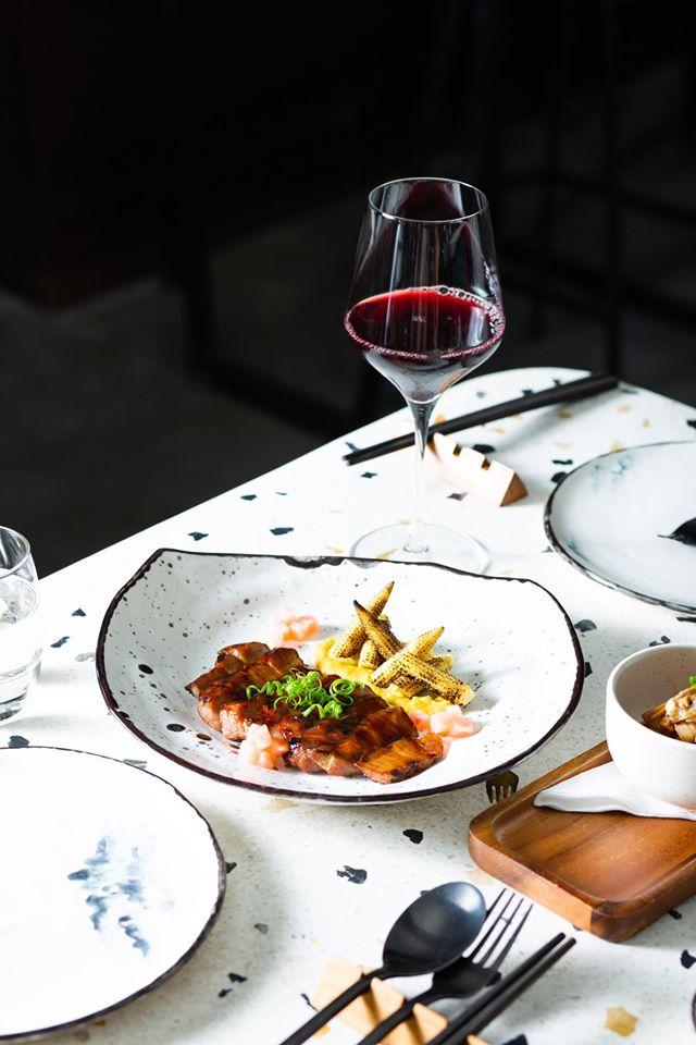 Iberico cut, wine and with cutlery set on table at Kiba Saigon