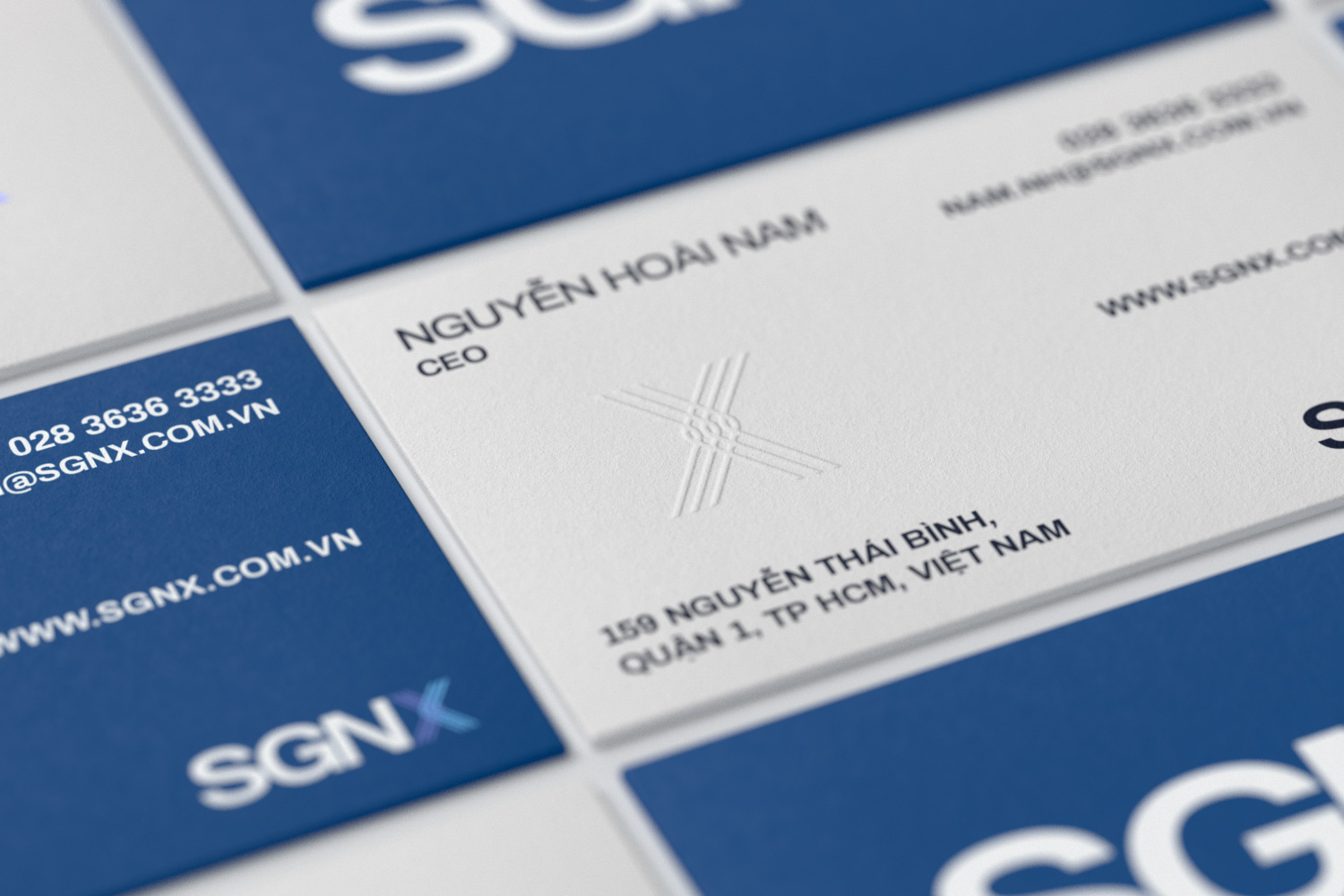 SGNX business card embossing detail