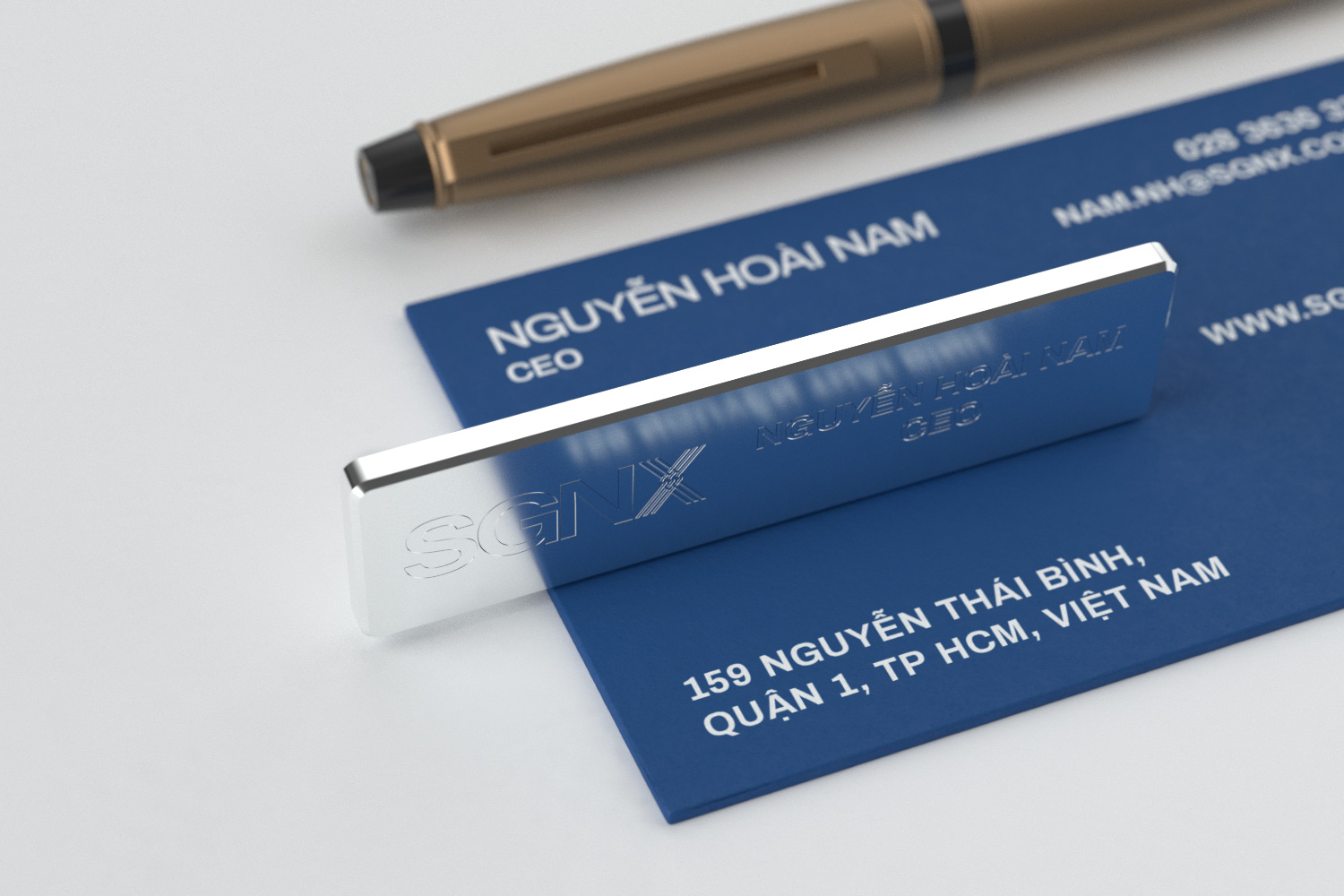 SGNX pin badge with business card