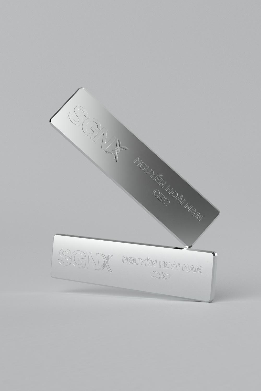 SGNX aluminum pin badge