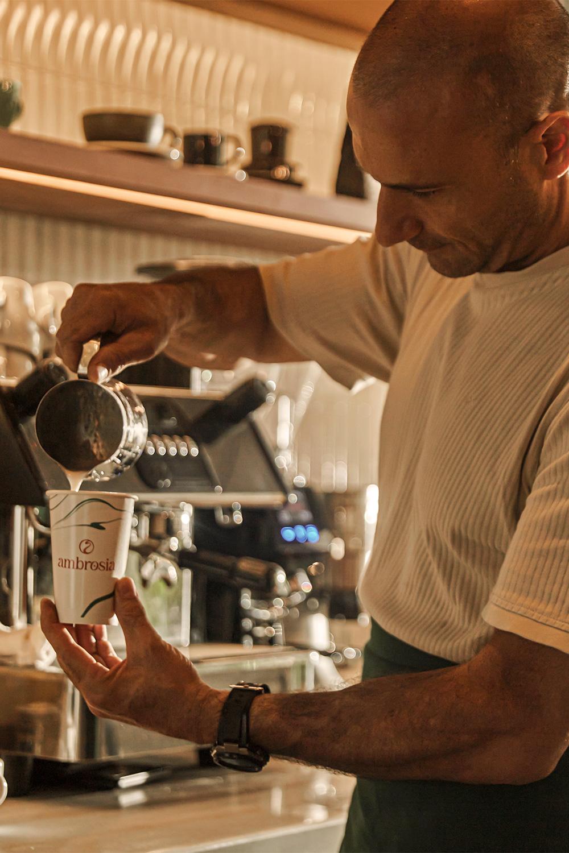 Ambrosia Barista Making A Latte