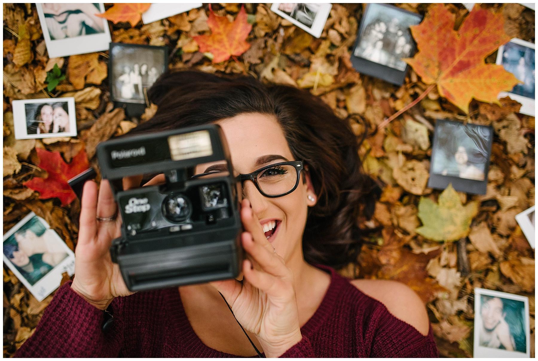 senior with polaroid camera