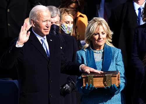 President Joe Biden swears at the Inauguration ceremony next to first lady, Jill Biden. U.S. Capitol, Washington, D.C. , Jan. 20, 2021