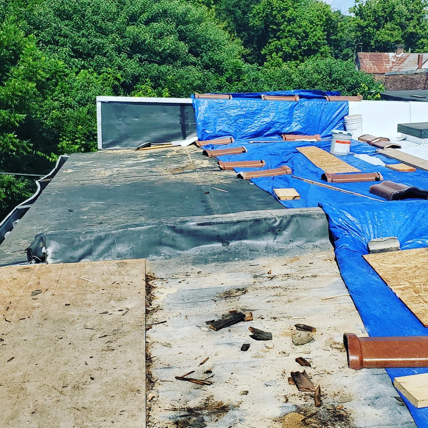 Beginning of installation and remaining removal of old roof in Petersburg, TN historic building