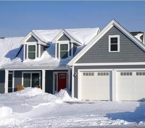 photo of home with the entire roof buried in snow