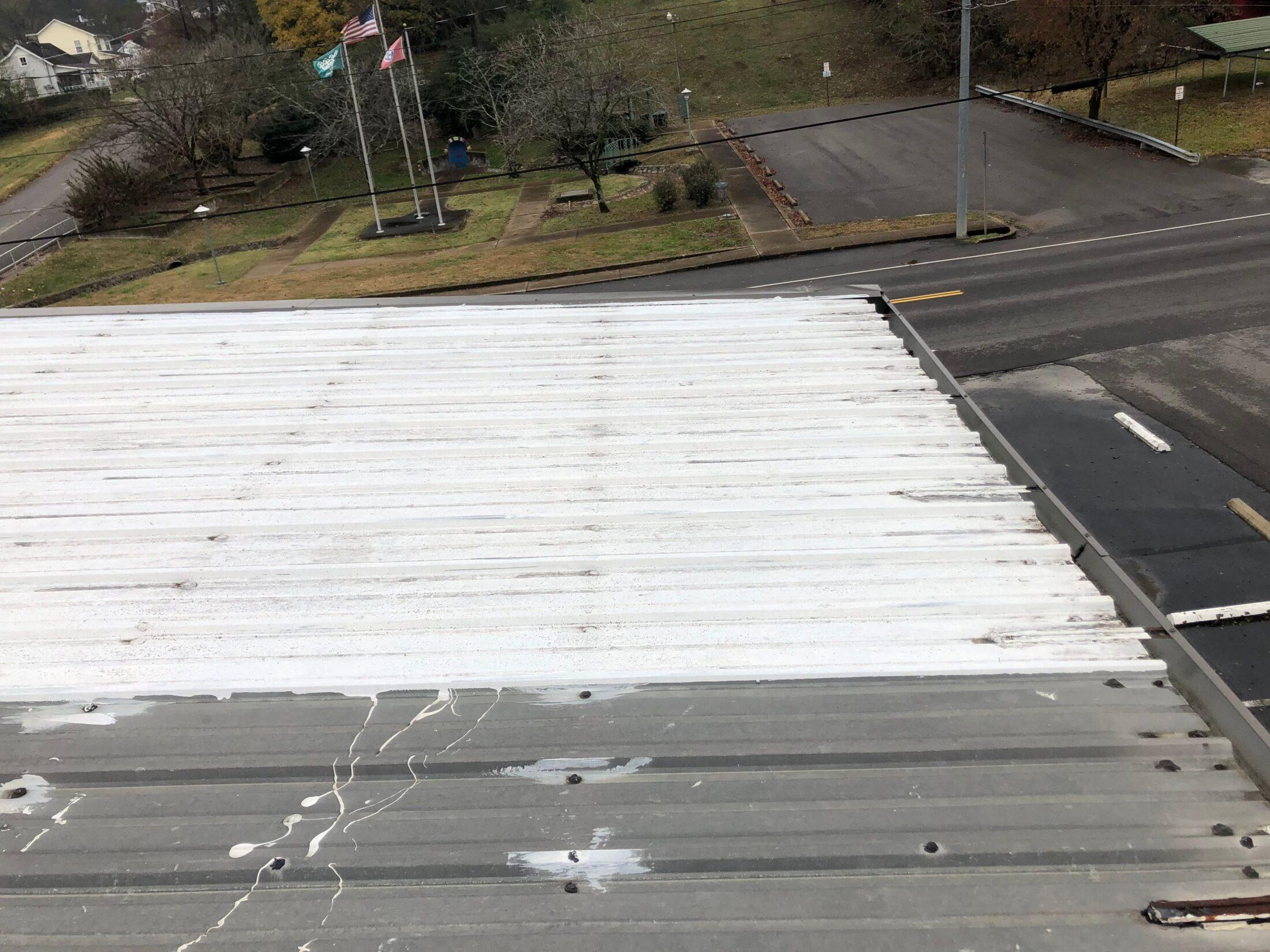 photo of old roof in Pulaski showing numerous areas of repair over the years. This is take prior to the replacement metal roof installation.