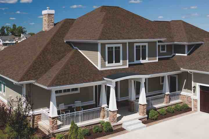 photo of home with new brownwood TDD architectural asphalt tiles