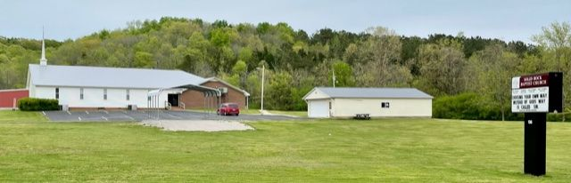 View from the road of Solid Rock Baptist Church wit the new roof in Old Town Grey 26 Guage Metal