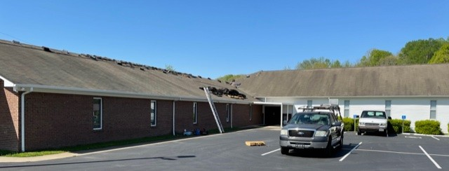 7H Roofing and Construction teams are removing the asphalt roof from the Solid Rock Baptist Church