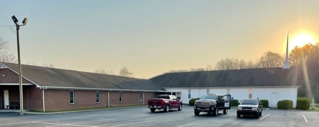 Starting at Sunrise! The sun lighting up the steeple of the Solid Rock Baptist Church as crews begin the replacement of the black asphalt roof with a new metal roof