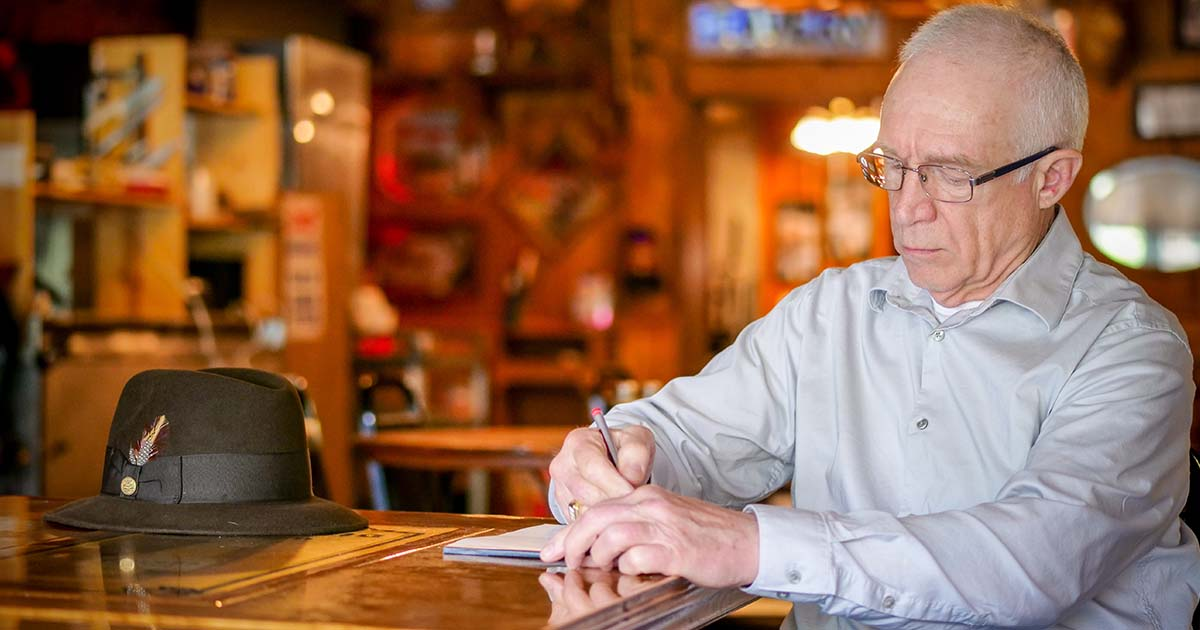 Randall M. Foster, author of TWO GUN JAKE, at his writer's desk answering FAQ