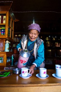 A Woman Serving Hot Drinks